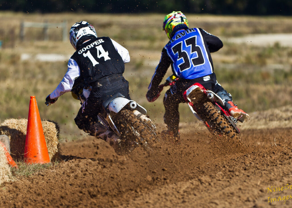 Todd Slavik riding motocross with Guy Cooper.