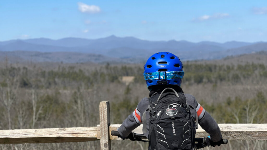 Kris Vermillion's son looking at the view while riding his mountain bike.