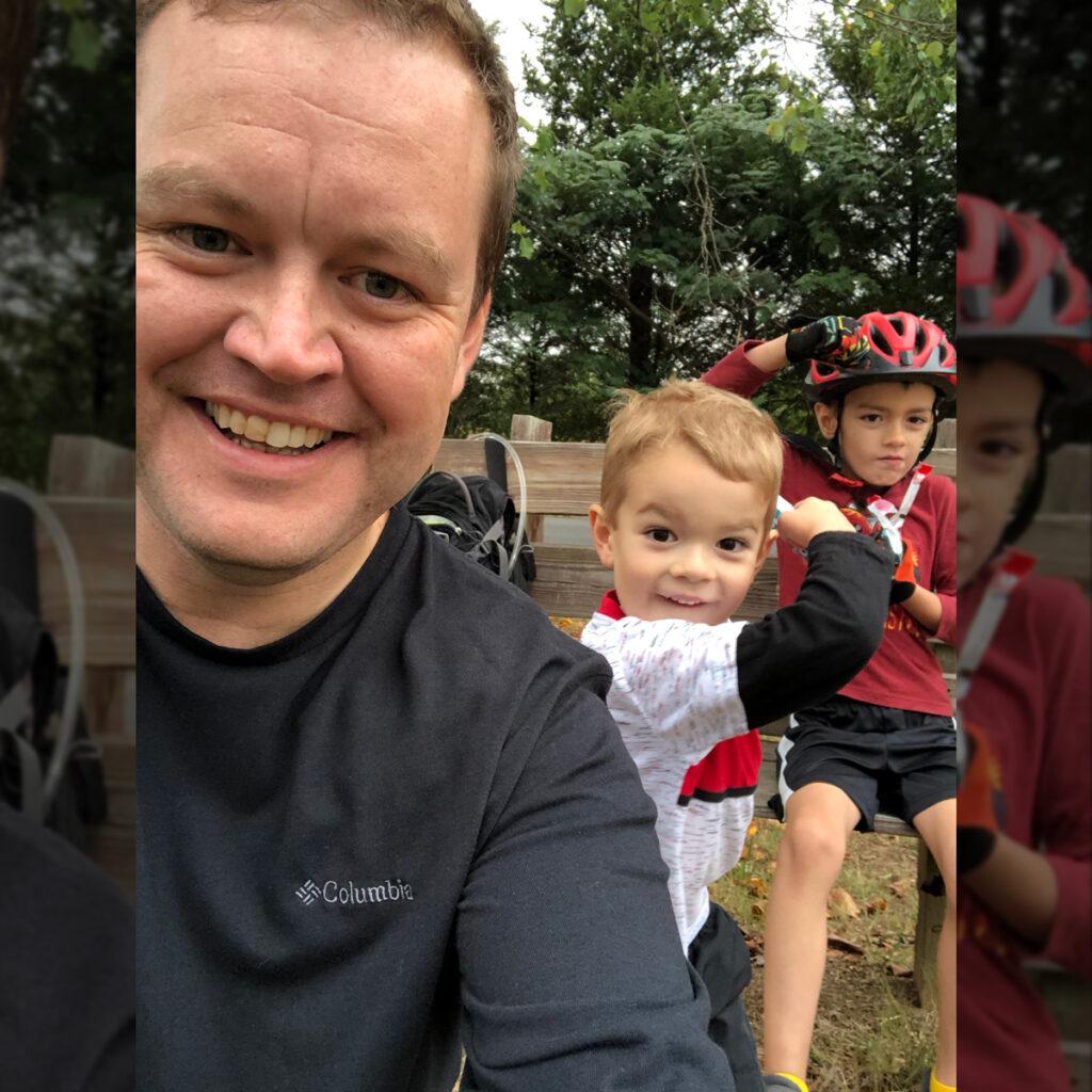 Kris Vermillion riding mountain bikes with his kids.