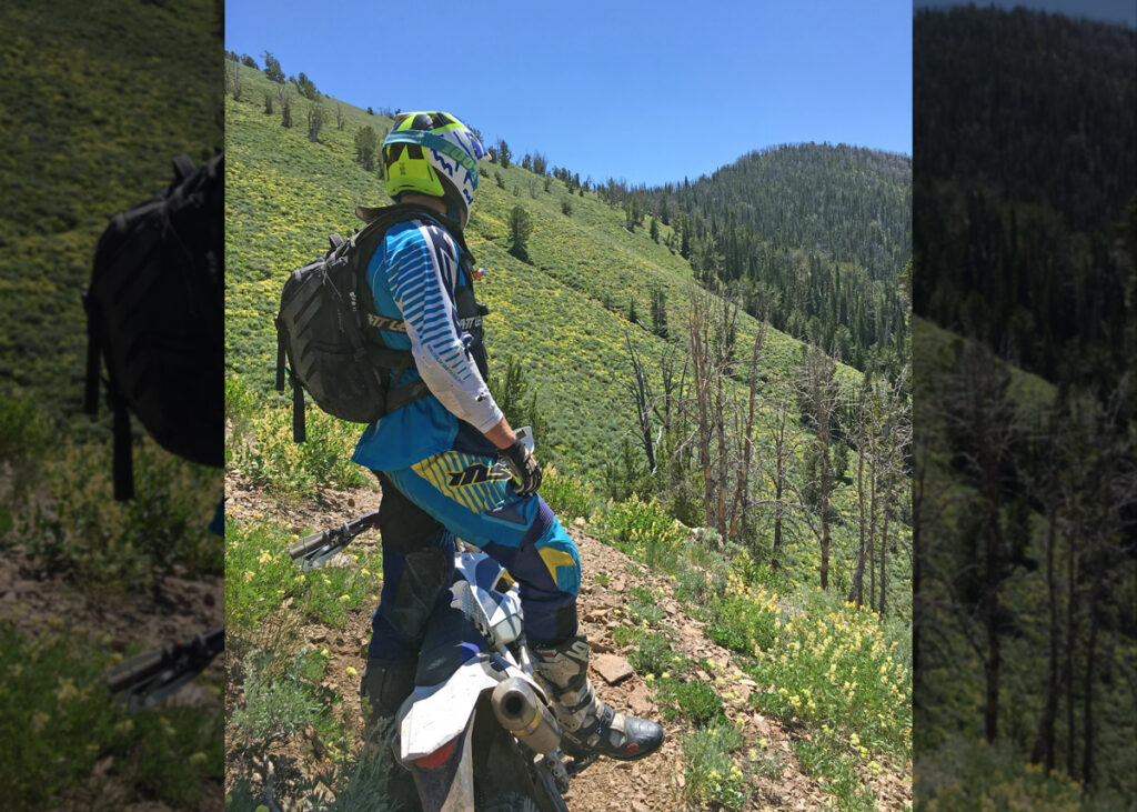 Dirt bike on a trail in the mountains.