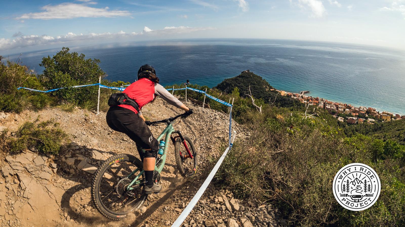 Porsha Murdock racing mountain bikes on the cliffs of Italy.