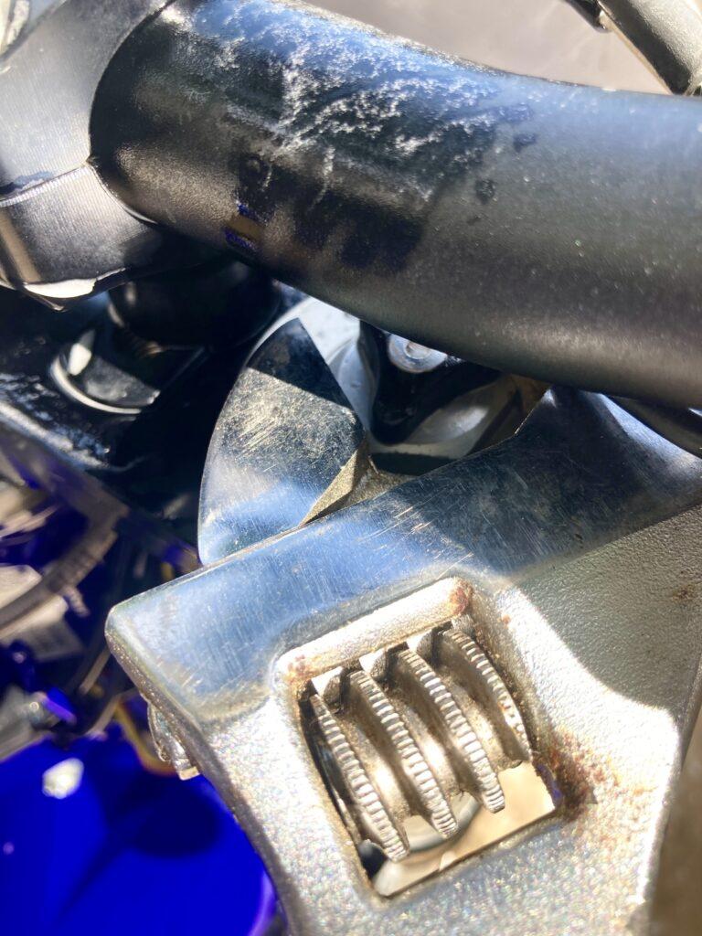Open crescent wrench on fork preload nut.