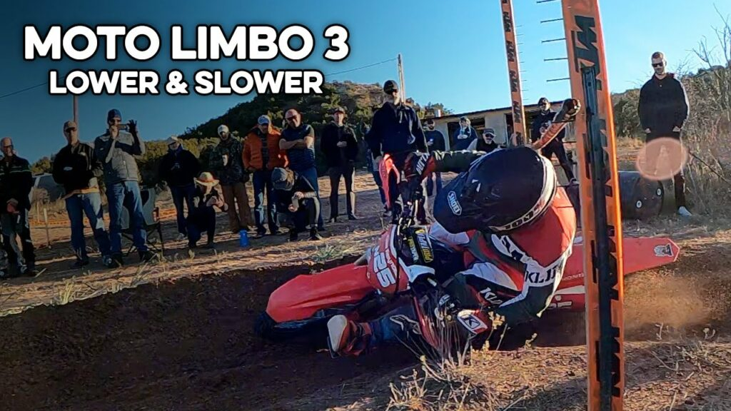 Cole Reynolds under the limbo bar on his Honda CR250F.