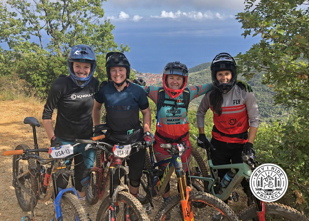 Mountain bike enduro racers all smiles on the trail.