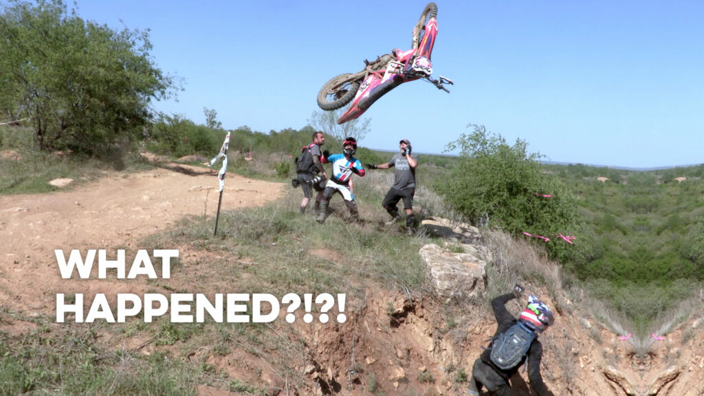 Hard Enduro Racer launching his dirt bike at the top of a hill climb.