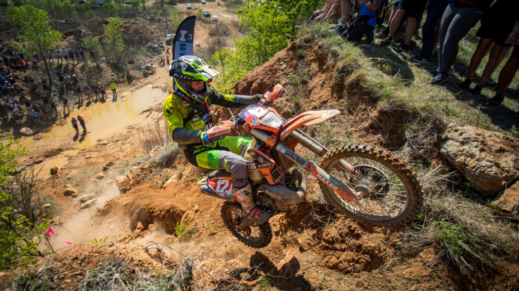 Cooper Abbott riding up a hill climb at the Revlimiter Extreme Enduro