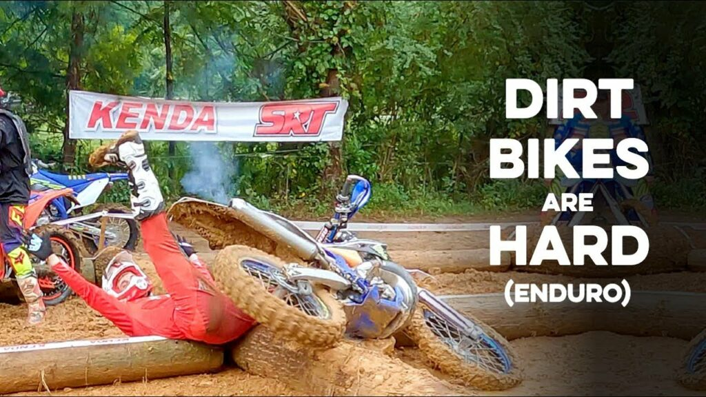 A hard enduro racer laying on his back after crashing in an endurocross section.